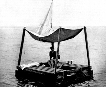Poon Lim sitting on a reconstruction of his raft, built at the request of the U.S. Navy