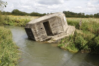 Pillbox sinking into the river